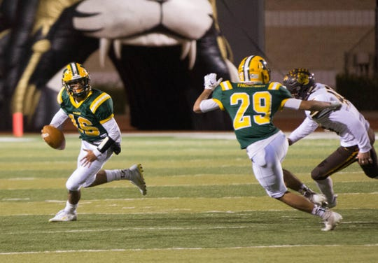 Mayfield's Quarterback Zach Ingram, looks for an open receiver before running the ball during the second quarter of the first round of Class 6A State Playoffs at the Field of Dreams, Friday November 9, 2018.