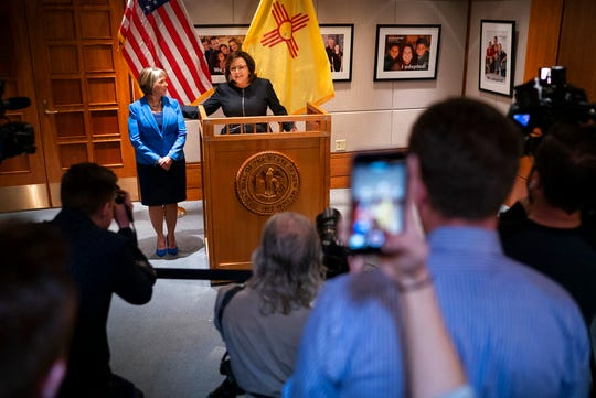 New Mexico Gov. Susana Martinez, center, and U.S. Rep. Michelle Lujan Grisham, who was elected Tuesday as the state's next governor, hold a join press conference after a the two to discuss the transition at the State Capitol in Santa Fe, N.M., on Friday, Nov. 9, 2018. Martinez, a Republican and the state's first female governor, has served two consecutive terms. Lujan Grisham, a Democrat, will take office Jan. 1, 2019.