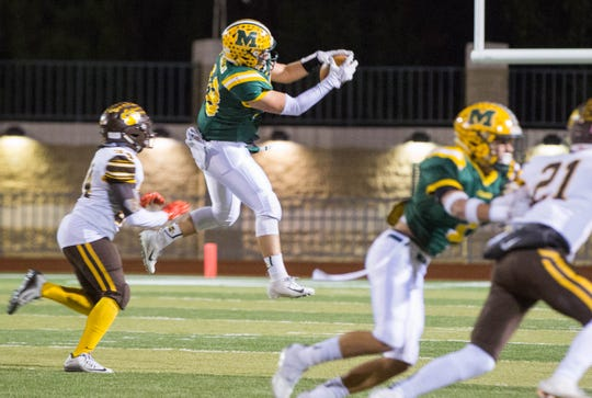 Jacob Moreno, 18, catches a pass during the first quarter of the first round of Class 6A State Playoffs at the Field of Dreams, Friday November 9, 2018.