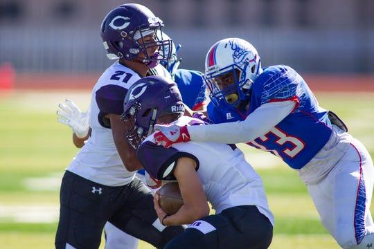 Las Cruces' Jonathan McRae brings down Clovis quarterback Chance Harris on Saturday at the Field of Dreams.