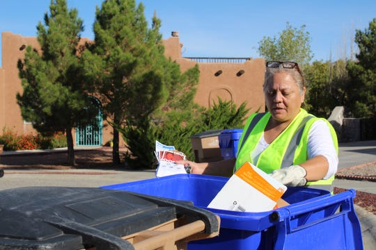 The SCSWA is checking blue recycling bins throughout Las Cruces over the next several weeks to help educate the public about what is and isn't recyclable. Cecelia Martinez, recycling auditor, examines materials diverted out of the trash and into the recycling bin.