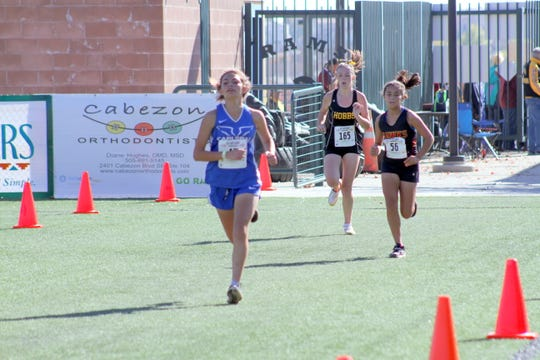Carlsbad's Shelby See kicks it into high gear at the end of Saturday's state cross country meet at Rio Rancho High. She finished the race in 81st place.