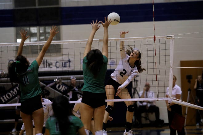 Piedra Vista's Kacee Moore hits the ball down the left corner for a kill against Farmington during Thursday's District 2-5A tournament semifinals at Jerry A. Conner Fieldhouse in Farmington. PV earned the No. 6 seed in the 5A playoffs, while Navajo Prep (No. 2 in 3A) and Kirtland Central (No. 7 in 4A) also made state.