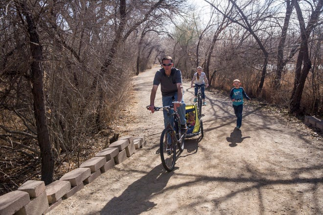 Jeremy McDainel rides bikes with his family on March 16 in Animas Park in Farmington. The City Council is seeking public comment on a proposal river trails expansion program.