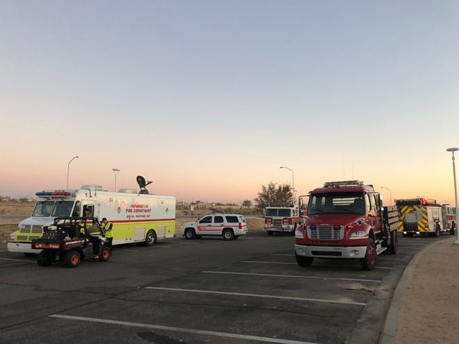 Units from the Farmington and San Juan County fire departments are positioned near the Northern Navajo Medical Center in Shiprock on Friday in response to a gas leak reported on the north side of the community.