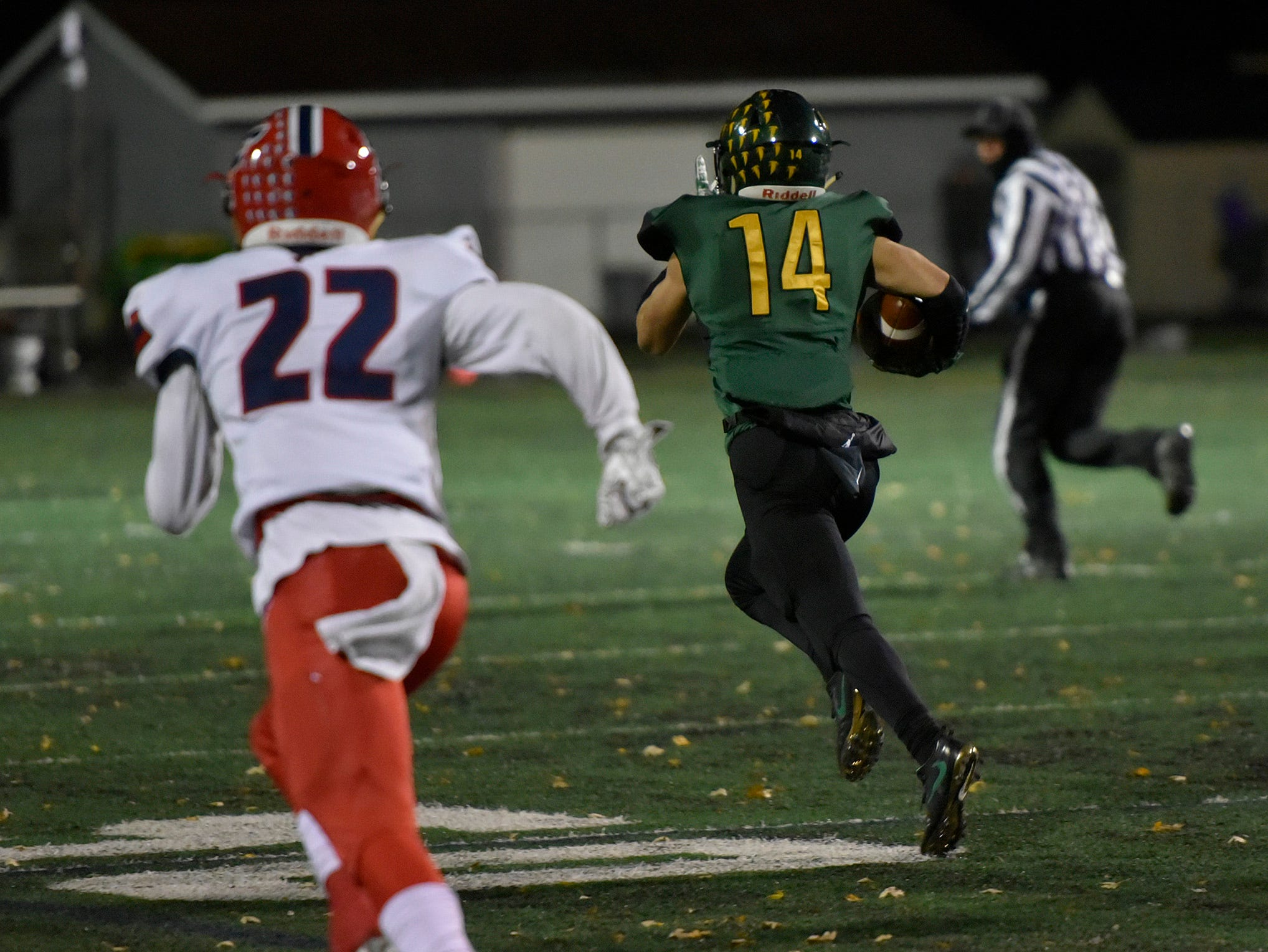 Birmingham Groves WR/DB Colby Taylor (14) has a clear path to the end zone for a touchdown. Livonia Franklin DB/SL James Carpenter can't catch him.