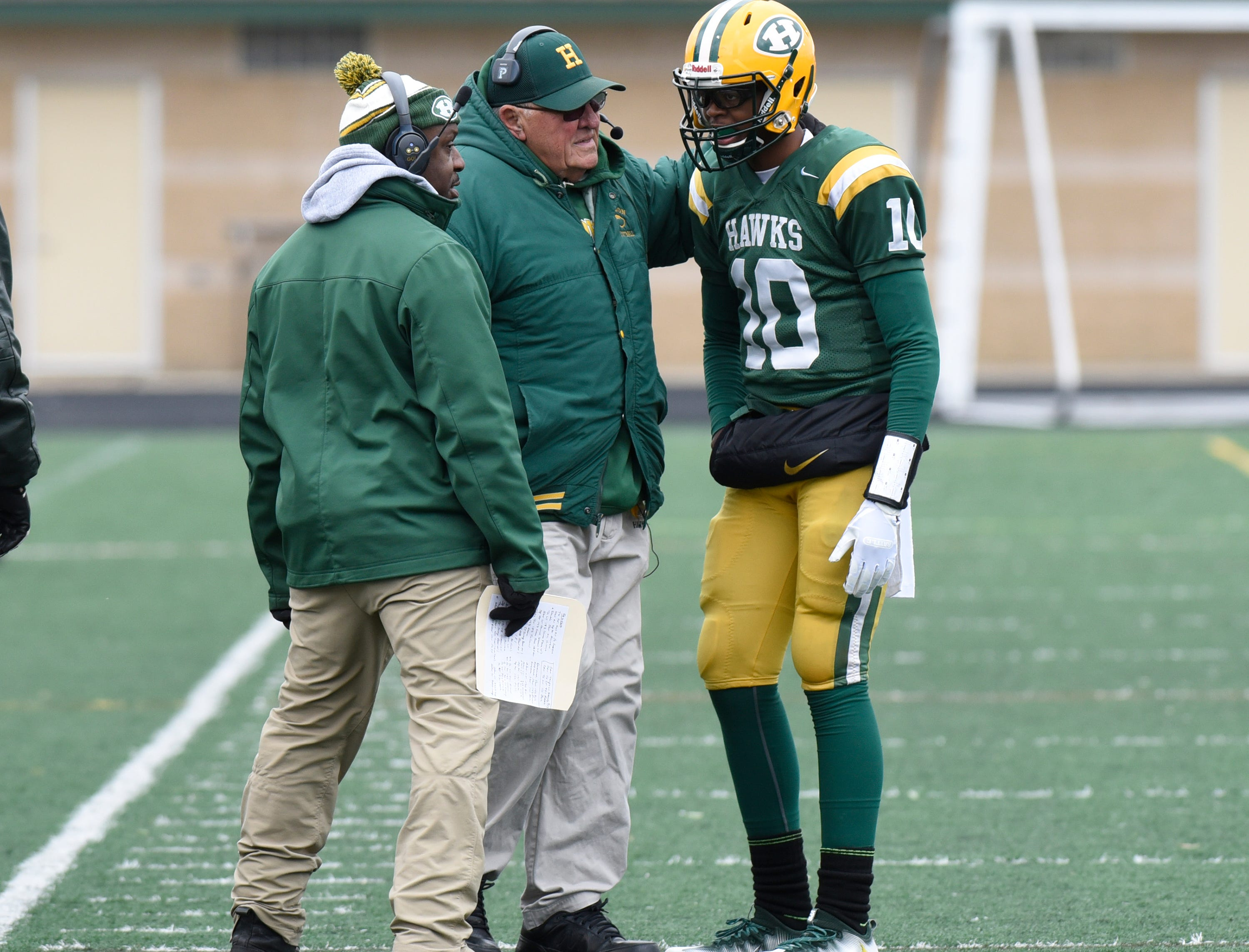 Farmington Harrison Head Coach John Herrington gives a play to Farmington Harrison QB Keel Watson (10) during first half of the Division 4 regional final against Chelsea played at Buller Field Nov. 10, 2018
