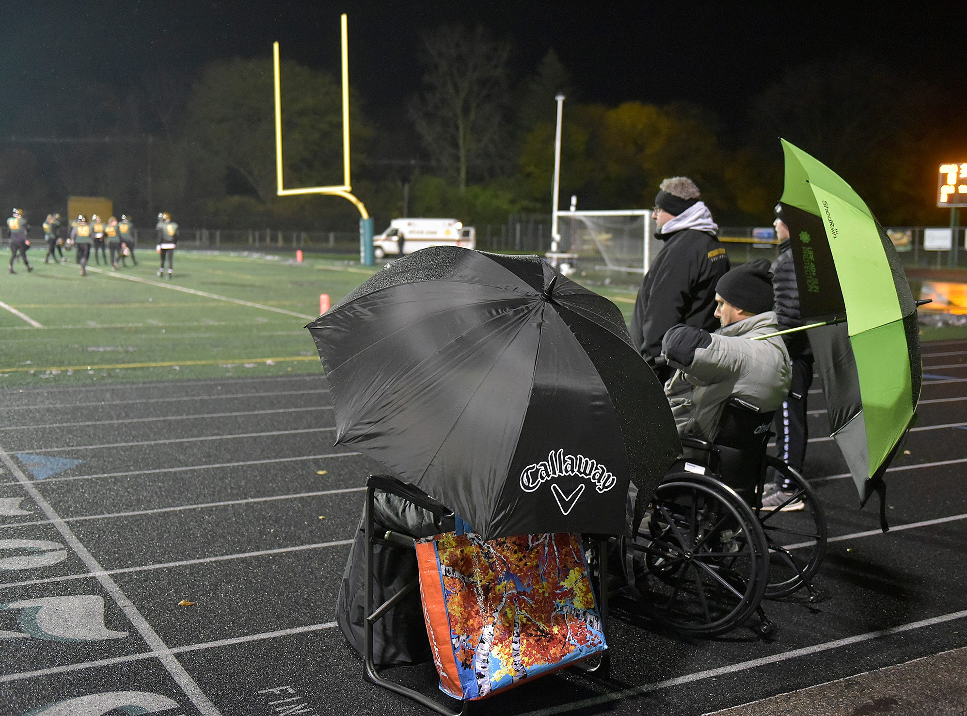 Drizzle, then snow showers didn't keep these Groves fans from the game against the Franklin Patriots.