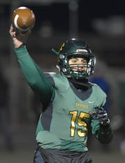 Birmingham Groves QB Markis Alexander(15) launches a pass.