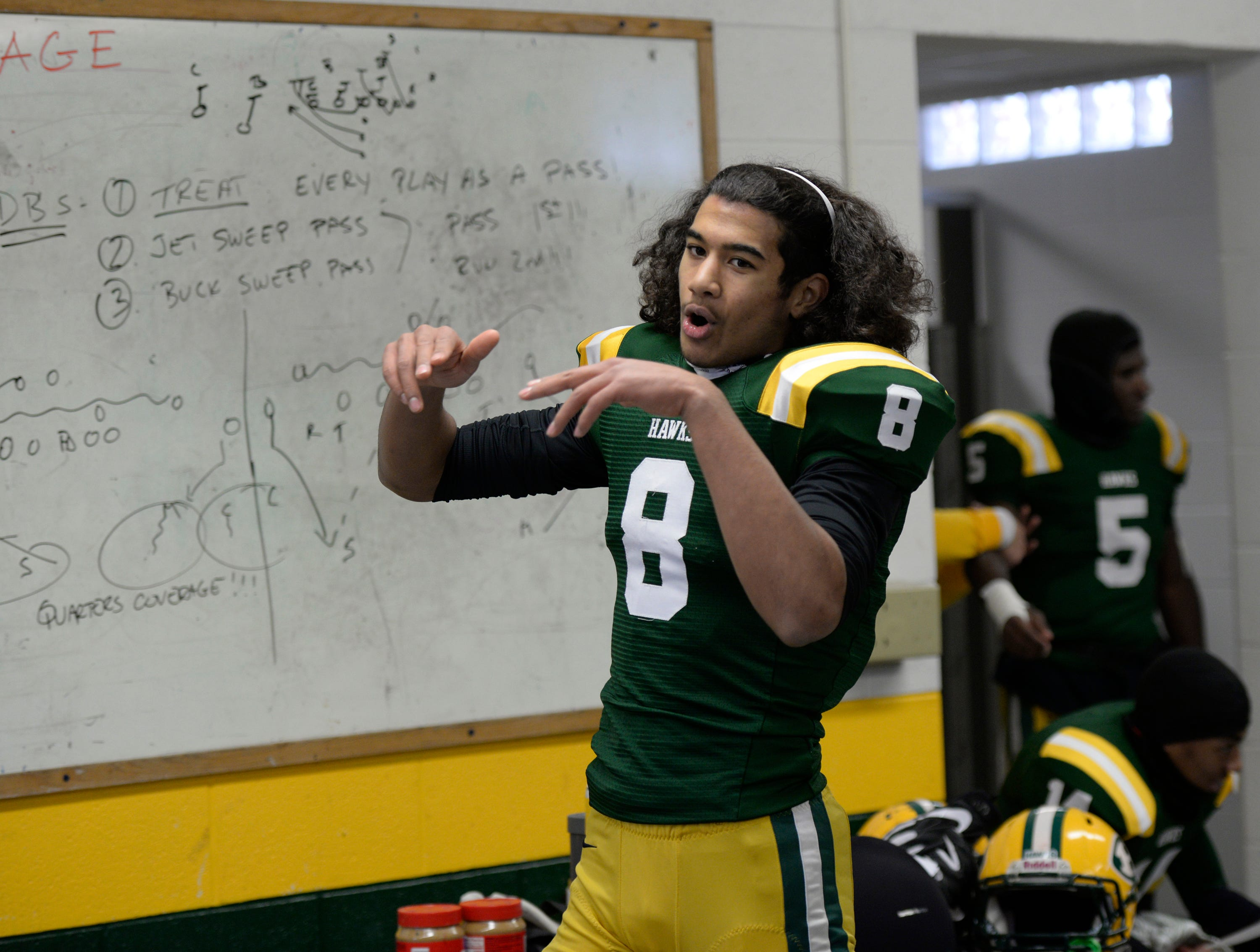 Farmington Harrison QB/DB Max Martin (8) fires up the team before the start of the Division 4 regional final played at Buller Field Nov. 10, 2018