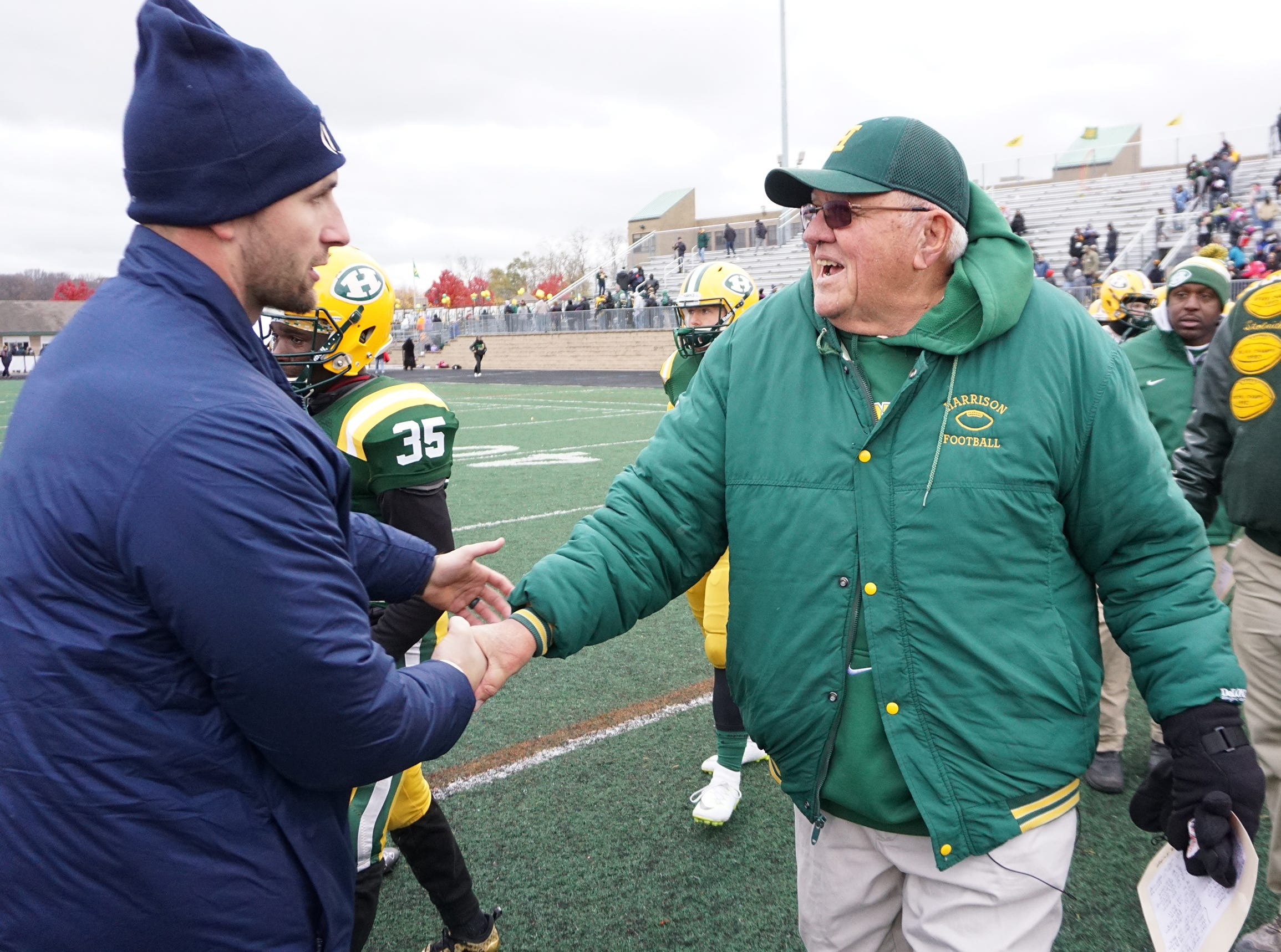 Farmington Harrison Head Coach John Herrington shakes hands with Chelsea Head Coach Josh Lucas after the Hawks lost 21-14 to Chelsea ending the season and the storied football program at Harrison.