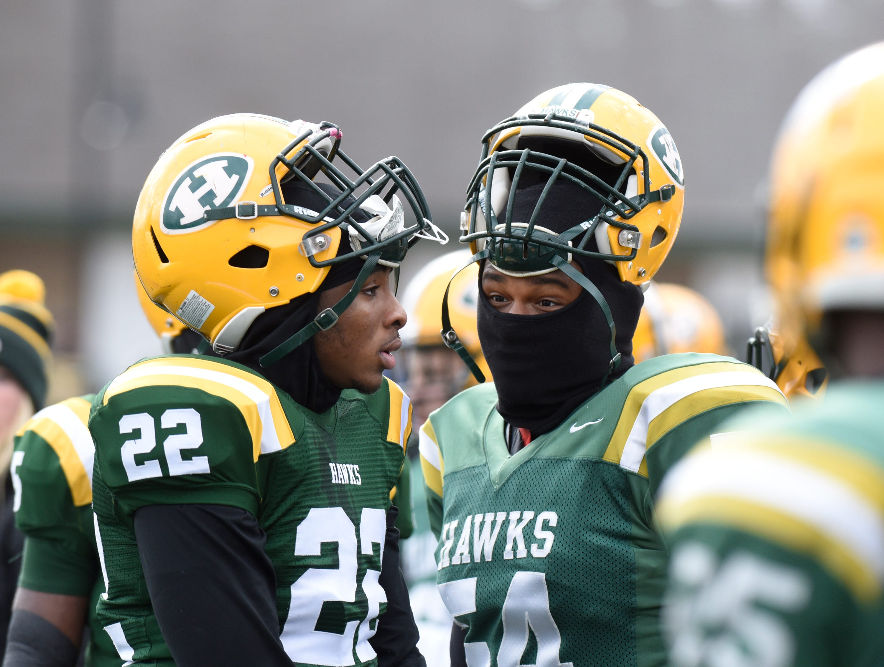 Farmington Harrison TE/LB Sylvon Brown (22) and OL/LB Donovan Colbert (54)during first half of the Division 4 regional final played at Buller Field Nov. 10, 2018