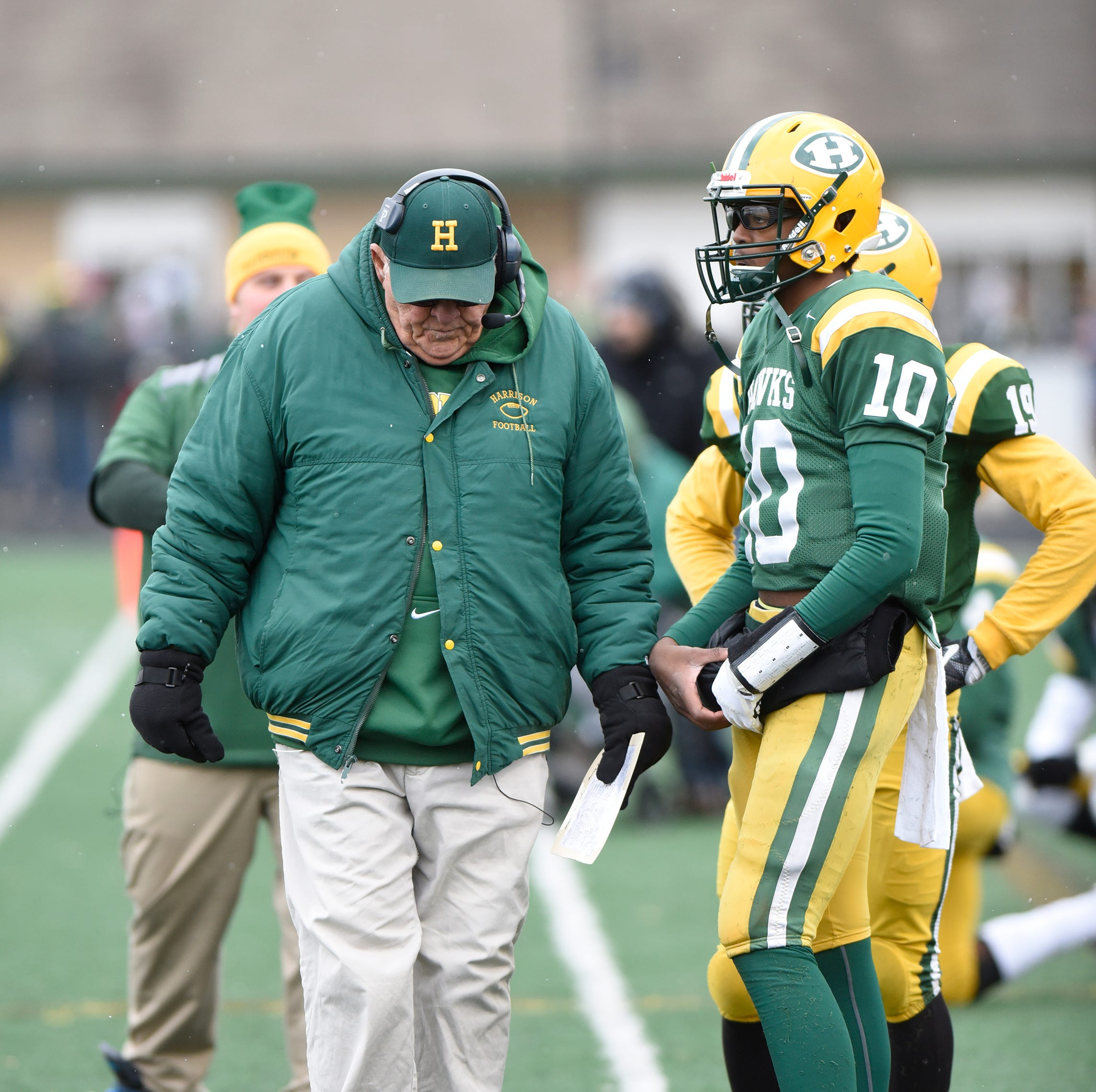 Farmington Harrison Head Coach John Herrington walks the sidelines near the end of the Division 4 regional final game won by Chelsea 21-14 - ending Herrington's and Harrison's storied football program.