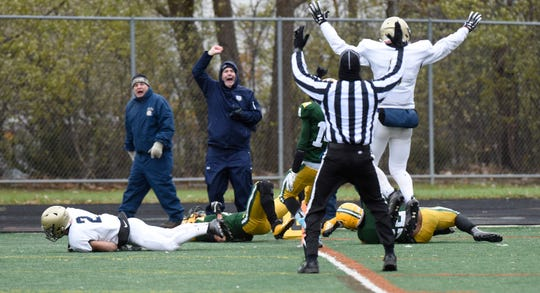 Chelsea RB Aaron McDaniels (2) falls into the end zone with the game-winning TD ending the season for Farmington Harrison in the Division 4 regional final played at Buller Field Nov. 10, 2018