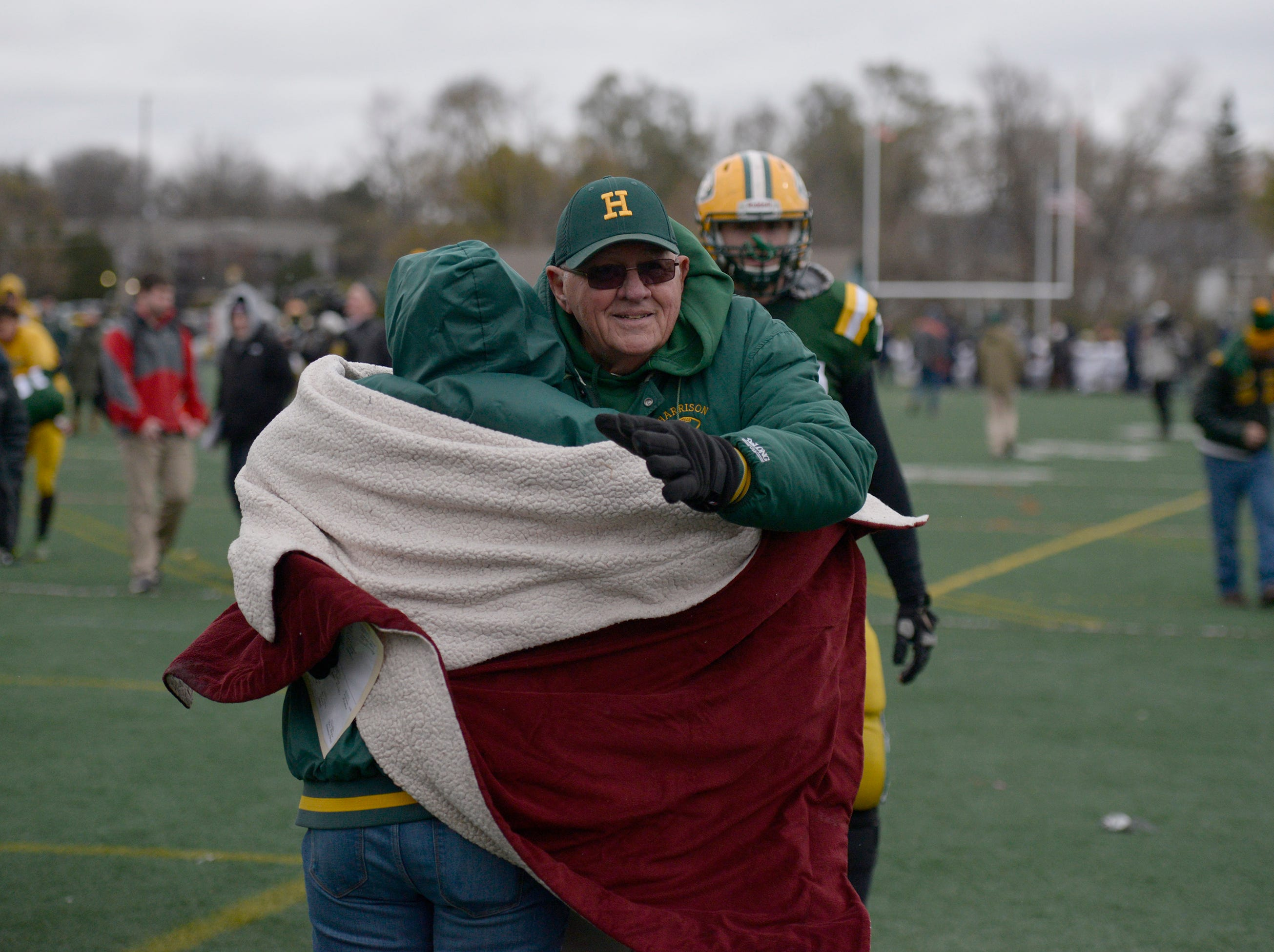 Farmington Harrison Head Coach John Herrington gets a hug after his team loss 21-14 in the Division 4 regional final played at Buller Field Nov. 10, 2018