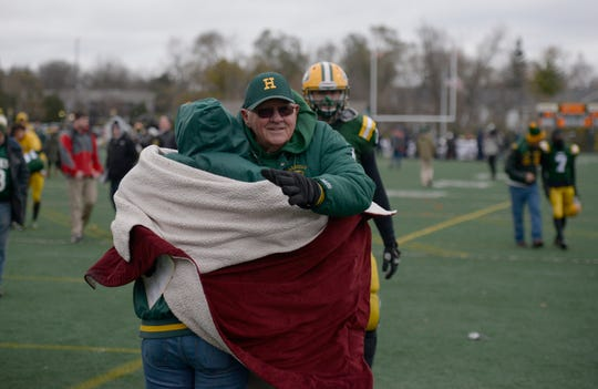 Farmington Harrison Head Coach John Herrington gets a hug after his team loss 21-14 in the Division 4 regional final played at Buller Field Nov. 10, 2018