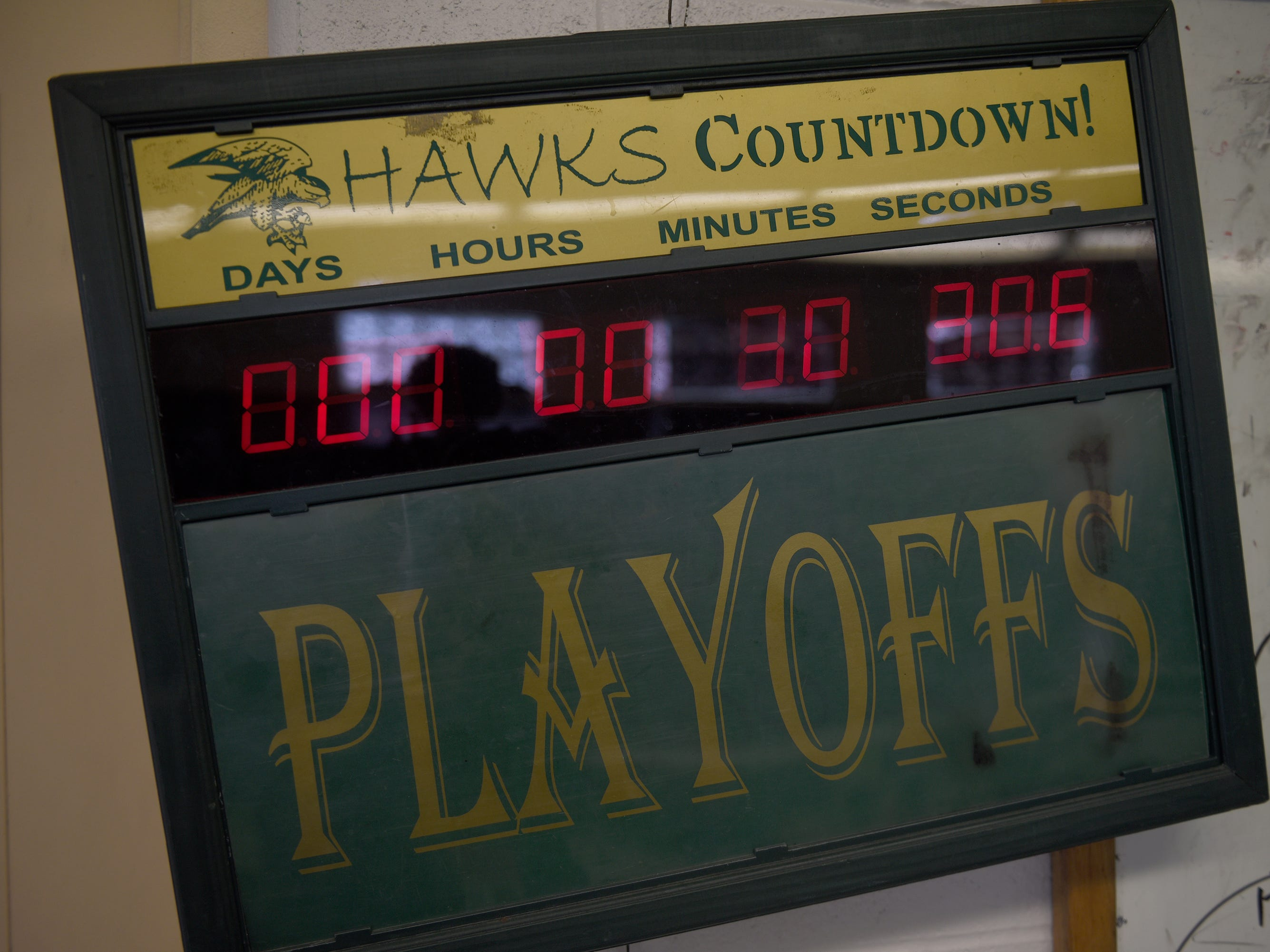 A clock in the locker room counts down the beginning of the last home game ever for Farmington Harrison before the start of the Division 4 regional final played at Buller Field Nov. 10, 2018