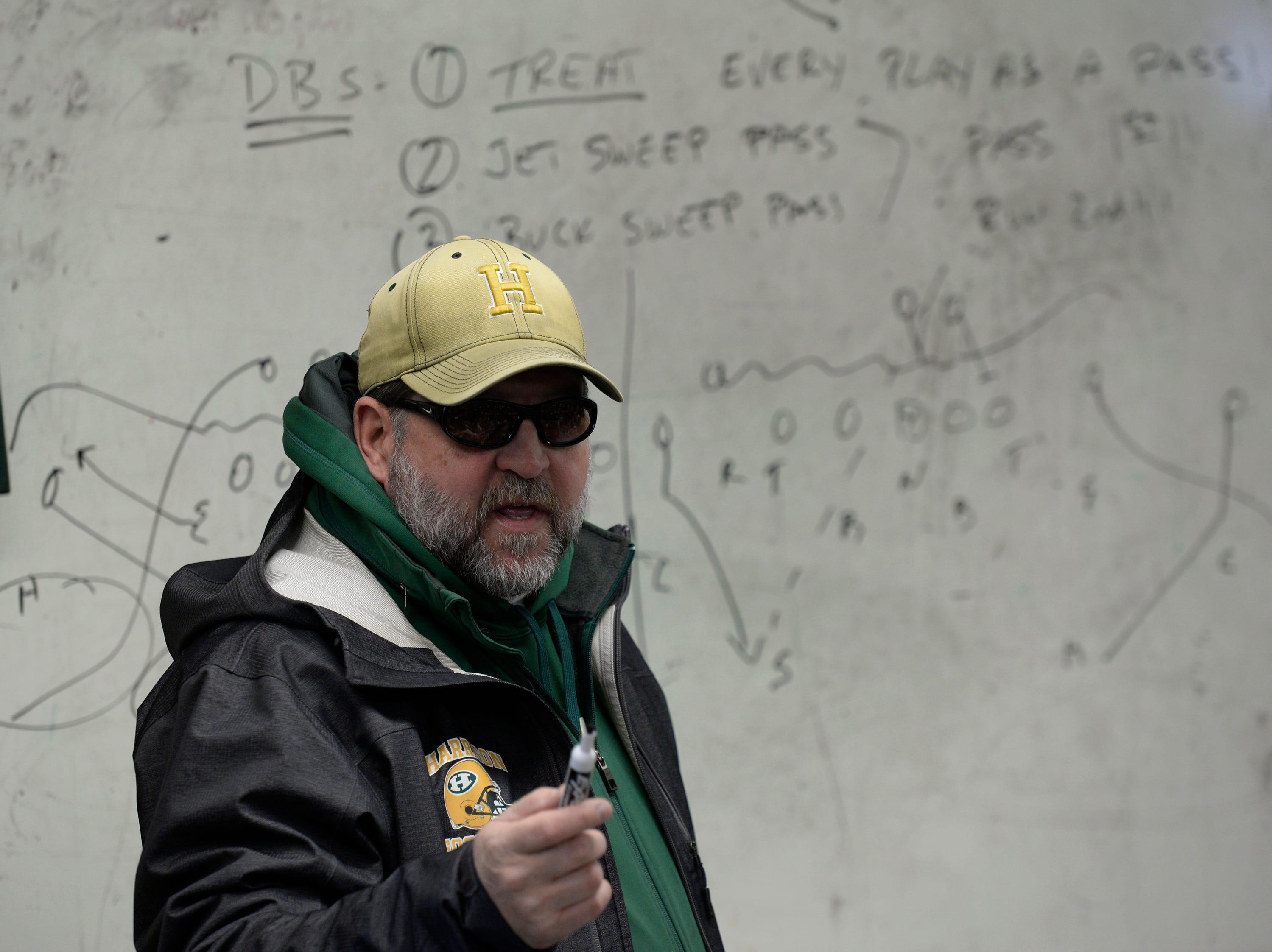 Farmington Harrison Assistant Coach Dave Thorn talks to the team f=before the start of the Division 4 regional final played at Buller Field Nov. 10, 2018