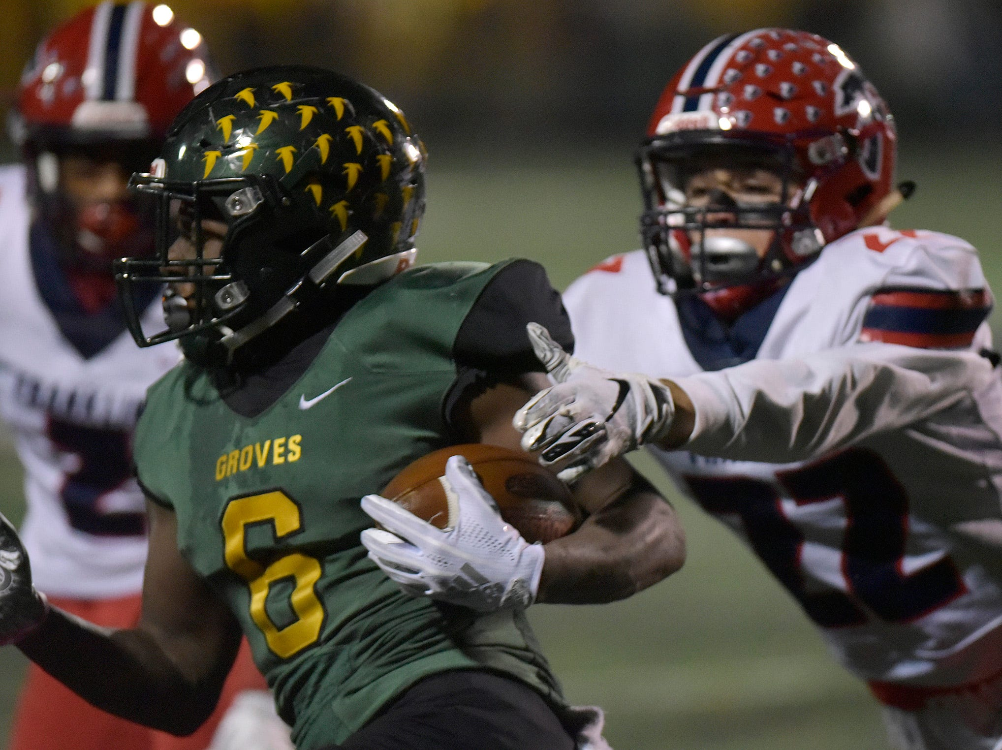 Birmingham Groves RB/FS Damonte McCurdy (6) gets past Franklin DB/SL James Carpenter (22).