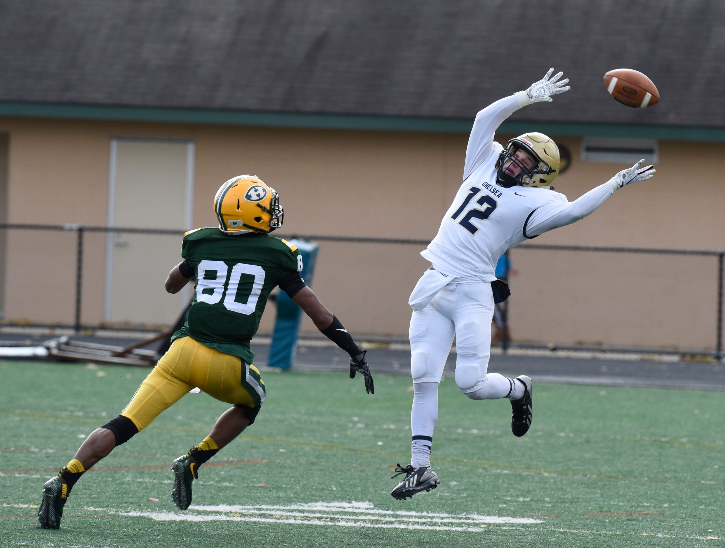 This pass is too high for RB/Wr Mitch Reynolds (12) as Farmington Harrison SE/DB Trenton Ramsey (80) covers during first half of the Division 4 regional final played at Buller Field Nov. 10, 2018