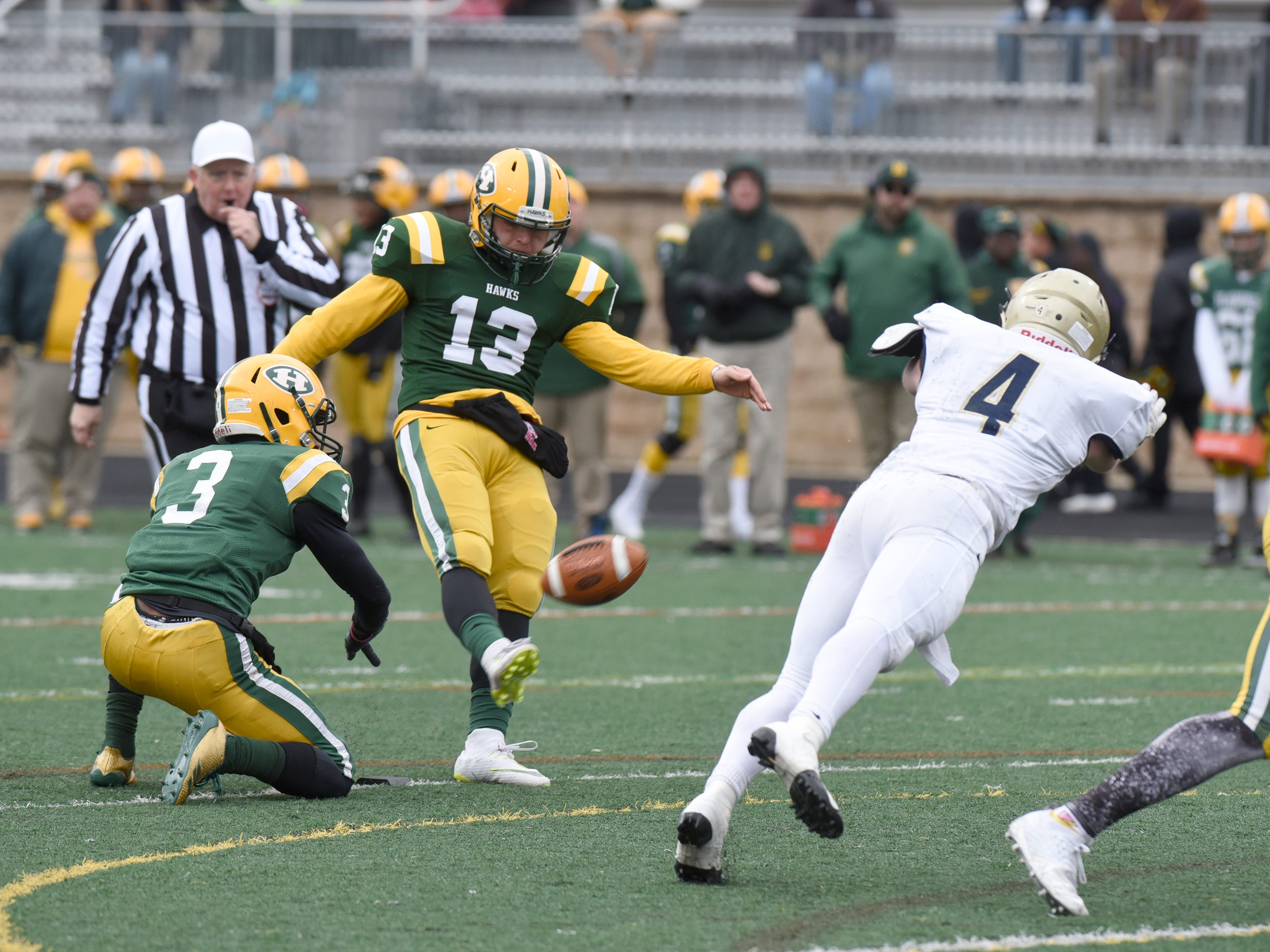Farmington Harrison Kicker/QB David Hiser (13) is good on the extra point during second half of the Division 4 regional final played at Buller Field Nov. 10, 2018