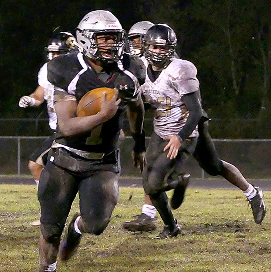 Montaze Sam moves away from the Berwick High defense on Friday. He finished the night with 383 rushing yards and five rushing touchdowns in the second half, as the Raiders advanced to the second round with a 46-39 win.