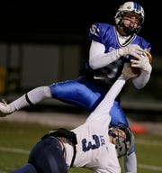 St. Mary's Springs' Cade Christensen makes a catch over Lake County Lutheran's Bryce Haertle for a large gain Friday in a WIAA Division 5 semifinal game.