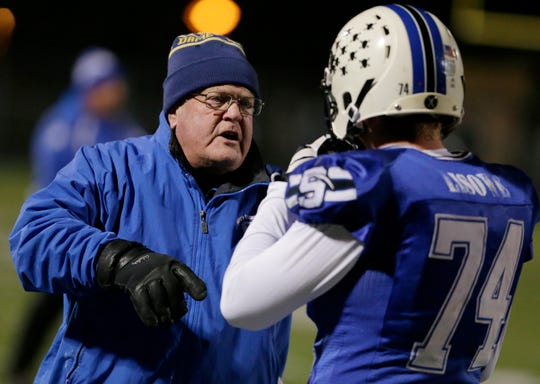 St. Mary's Springs coach Bob Hyland talks with Jacob Lisowe during Friday night's semifinal game in West Bend.