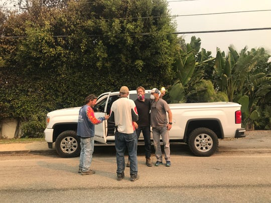 Tim Biglow, Malibu resident, and his neighbors talk about what homes were saved and which were lost during the Woolsey Fire Saturday morning