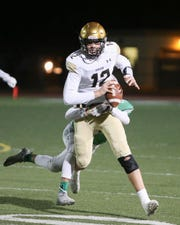 Xavier Prep QB Brad McClure gets stopped behind the line of scrimmage. The Xavier Prep varsity football team won Friday's CIF  playoff game against Nogales by a score of 24-21.