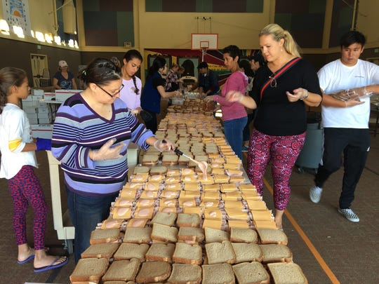 Volunteers at Casa Pacifica in Camarillo make sandwiches for first responders dealing with the Woolsey Fire. The effort was organized by World Central Kitchen, which often assists victims of wildfires.