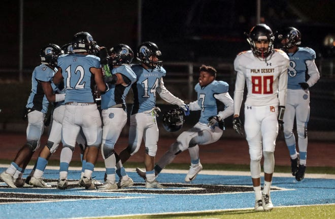 San Gorgonio celebrate their interception in their own end zone against Palm Desert in the final seconds of the first half on Friday, November 9, 2018 in San Bernardino during the CIF Southern Section 2nd round playoff.