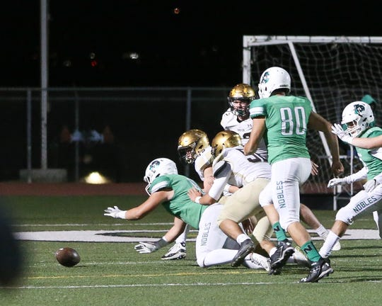 Nogales can't recover a blocked punt near the end zone that Xavier Prep  picked up for a special teams  touchdown. The Xavier Prep varsity football team won Friday's CIF playoff game against Nogales by a score of 24-21.