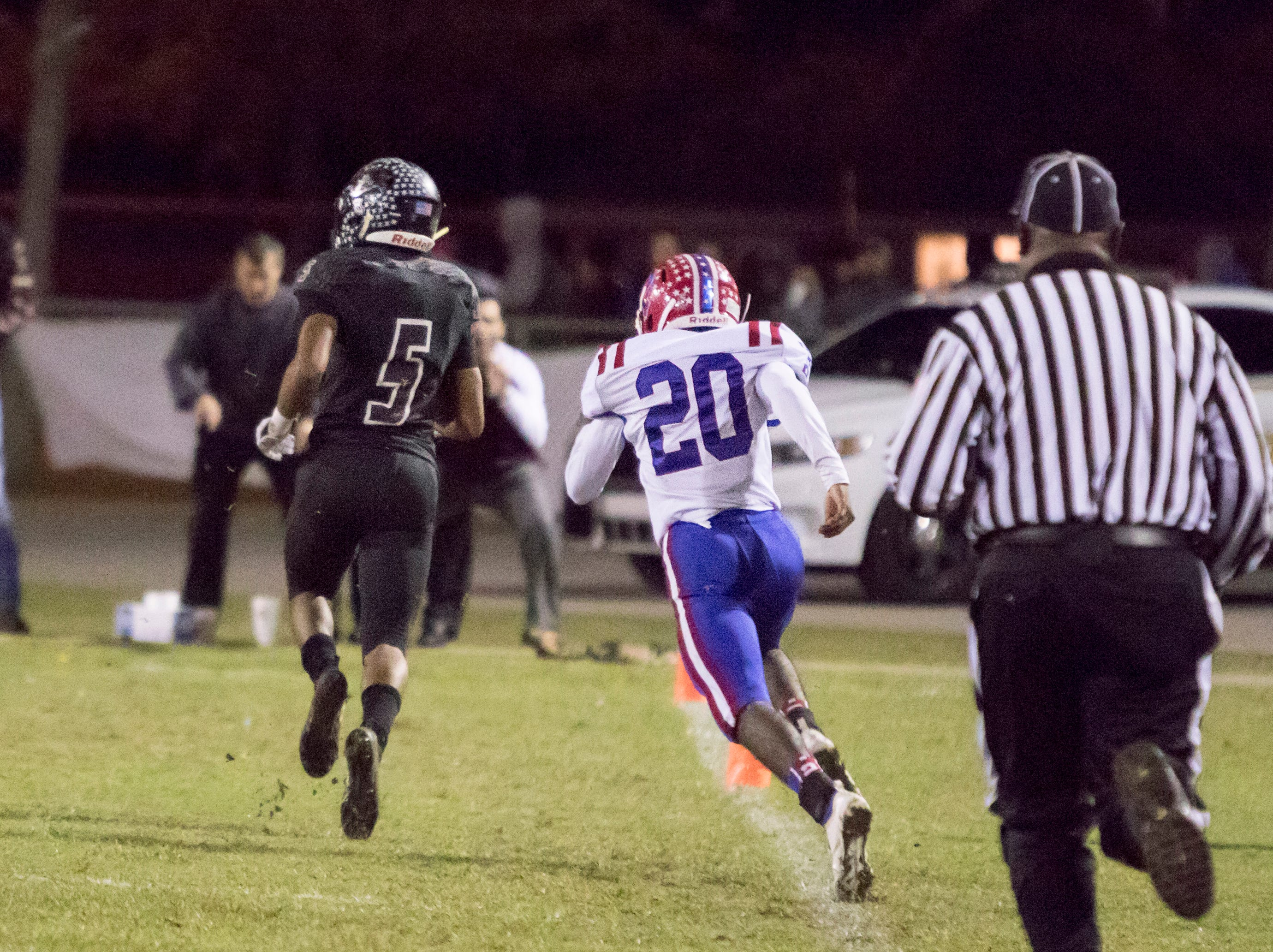 Dante Wright (5) finds open field on his way to a touchdown and a 31-0 lead after the Raiders added the extra point during the Pace vs Navarre playoff football game at Navarre High School on Friday, November 9, 2018.