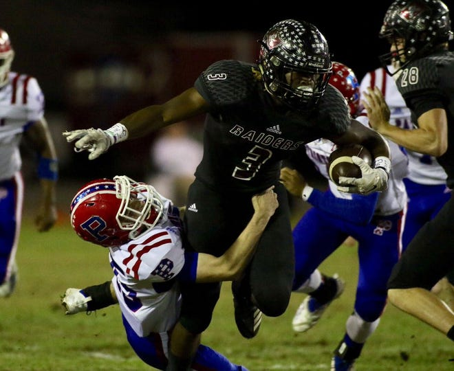 Navarre running back Chris Williams carries the ball against Pace in Class 6A-Region 1 state playoff action on Friday night at Navarre High School. (Nov. 9, 2018)