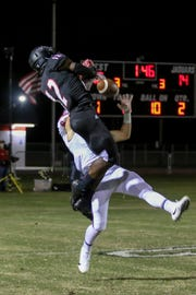 West Florida Tech wide receiver Simeon Price (12) makes an acrobatic catch against defender Connor Smith (6) in the Region 1-5A quarterfinal game against Jacksonville Bolles. The ball bounced off of both players and never touched the ground before Price caught it a nd was one of the most spectacular catches of last season.
