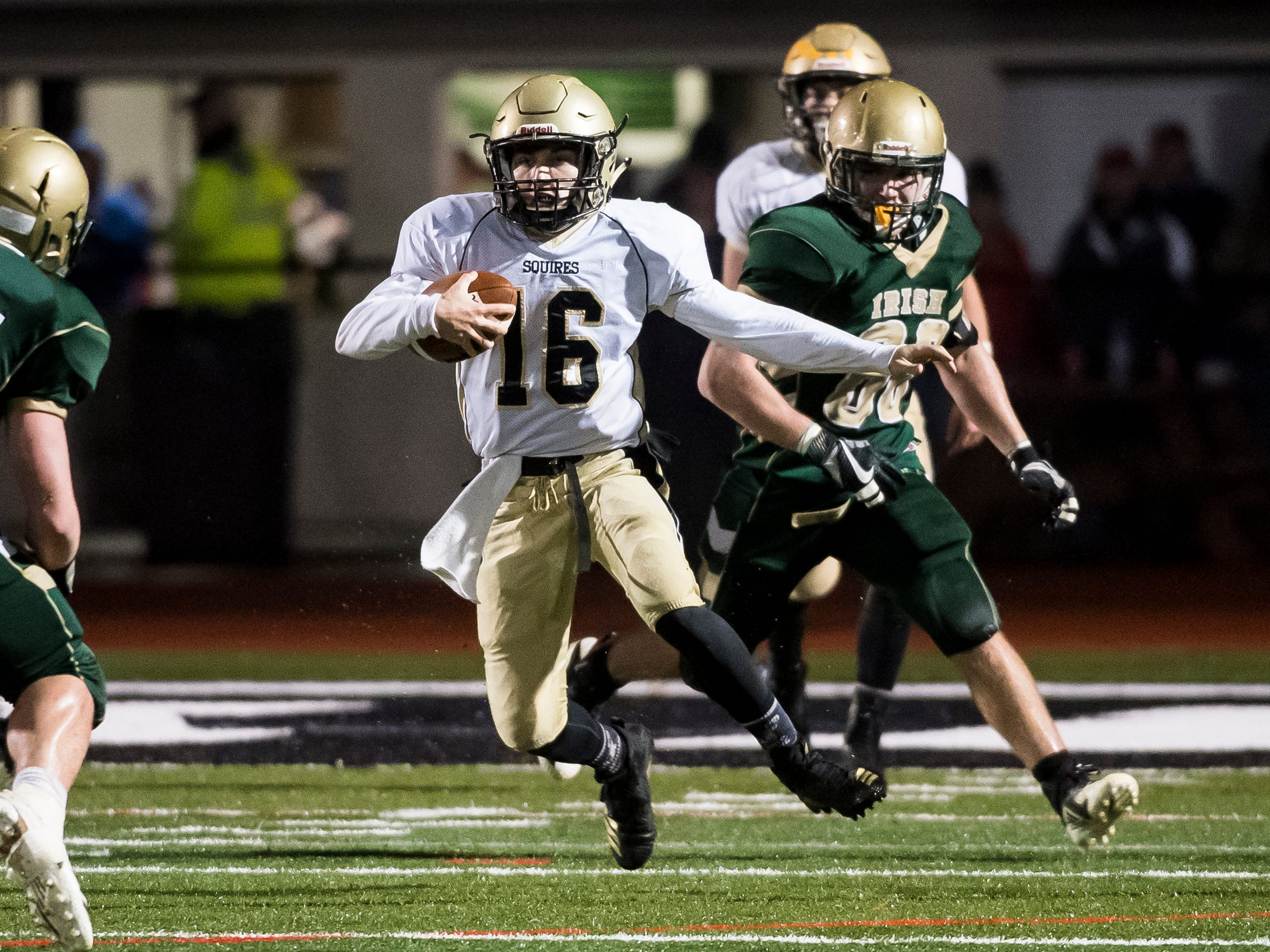 Delone Catholic's Evan Brady runs the ball against York Catholic in the PIAA District 3 Class 2A championship game at South Western High School on Friday, November 9, 2018. The Squires fell 28-21 in overtime.