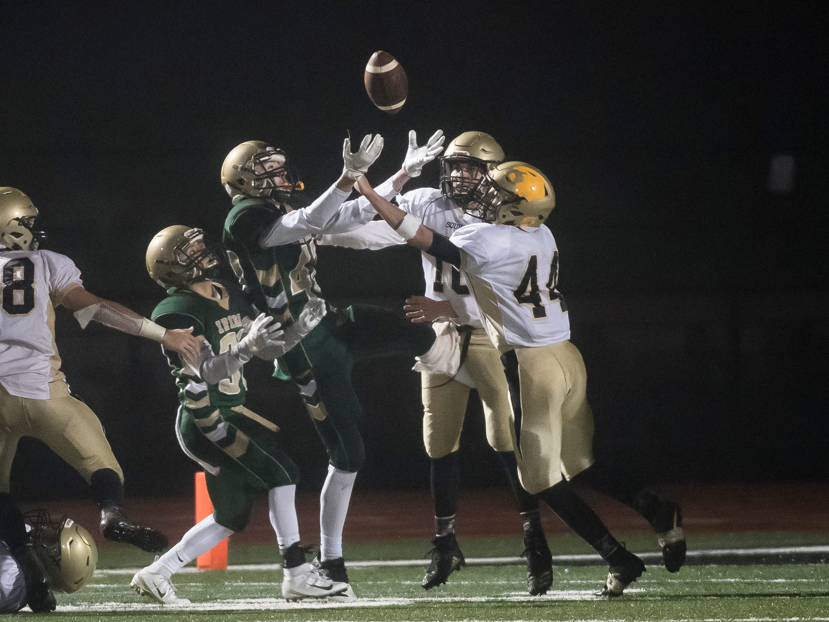 A York Catholic pass  is tipped and intercepted by Delone Catholic's Evan Brady in the PIAA District 3 Class 2A championship game at South Western High School on Friday, November 9, 2018. The Squires fell 28-21 in overtime.