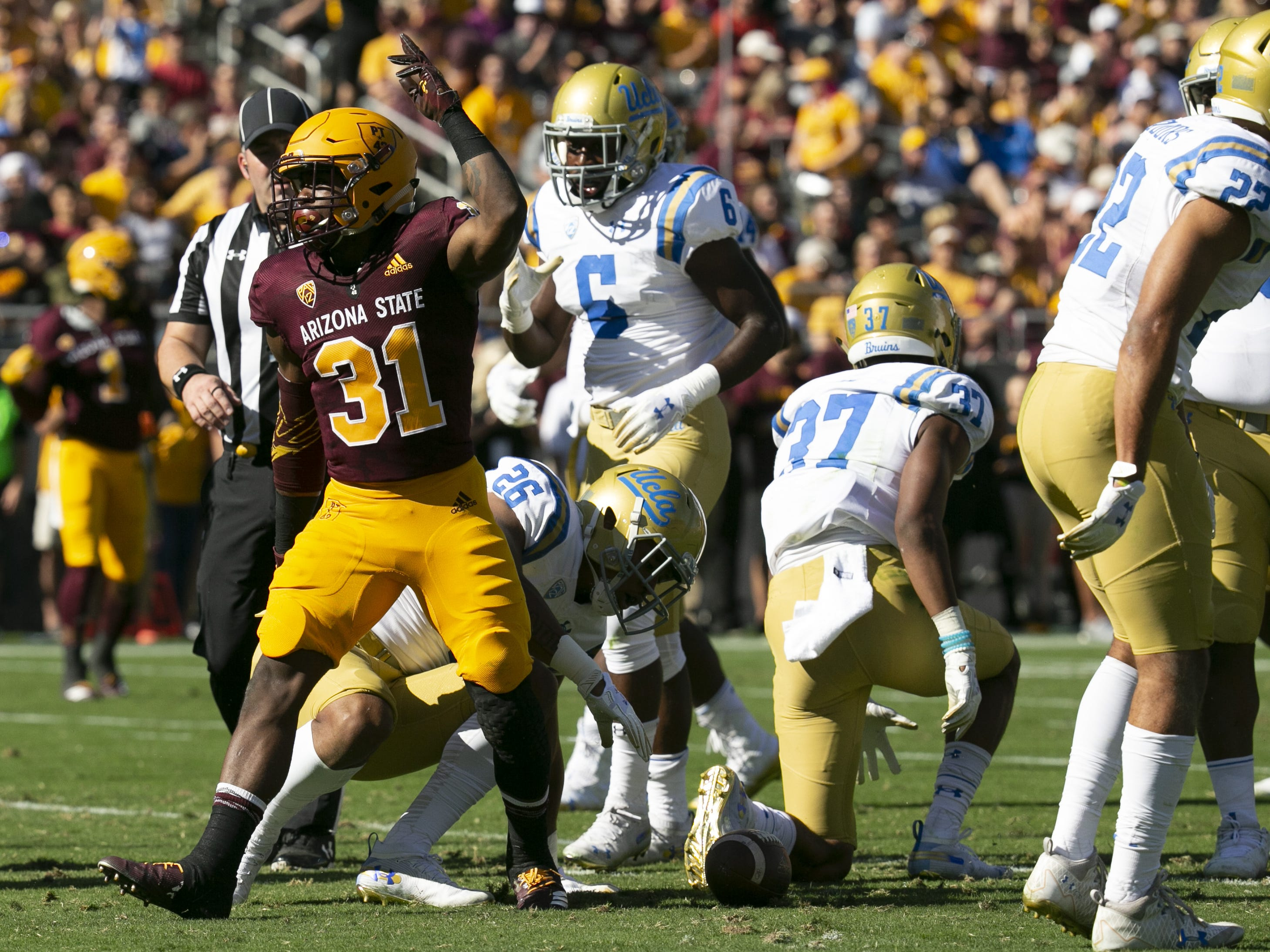 ASU running back Isaiah Floyd reacts after getting a first down on a carry against UCLA during the second quarter of the PAC-12 college football game at Sun Devil Stadium in Tempe on Saturday, November 10, 2018.