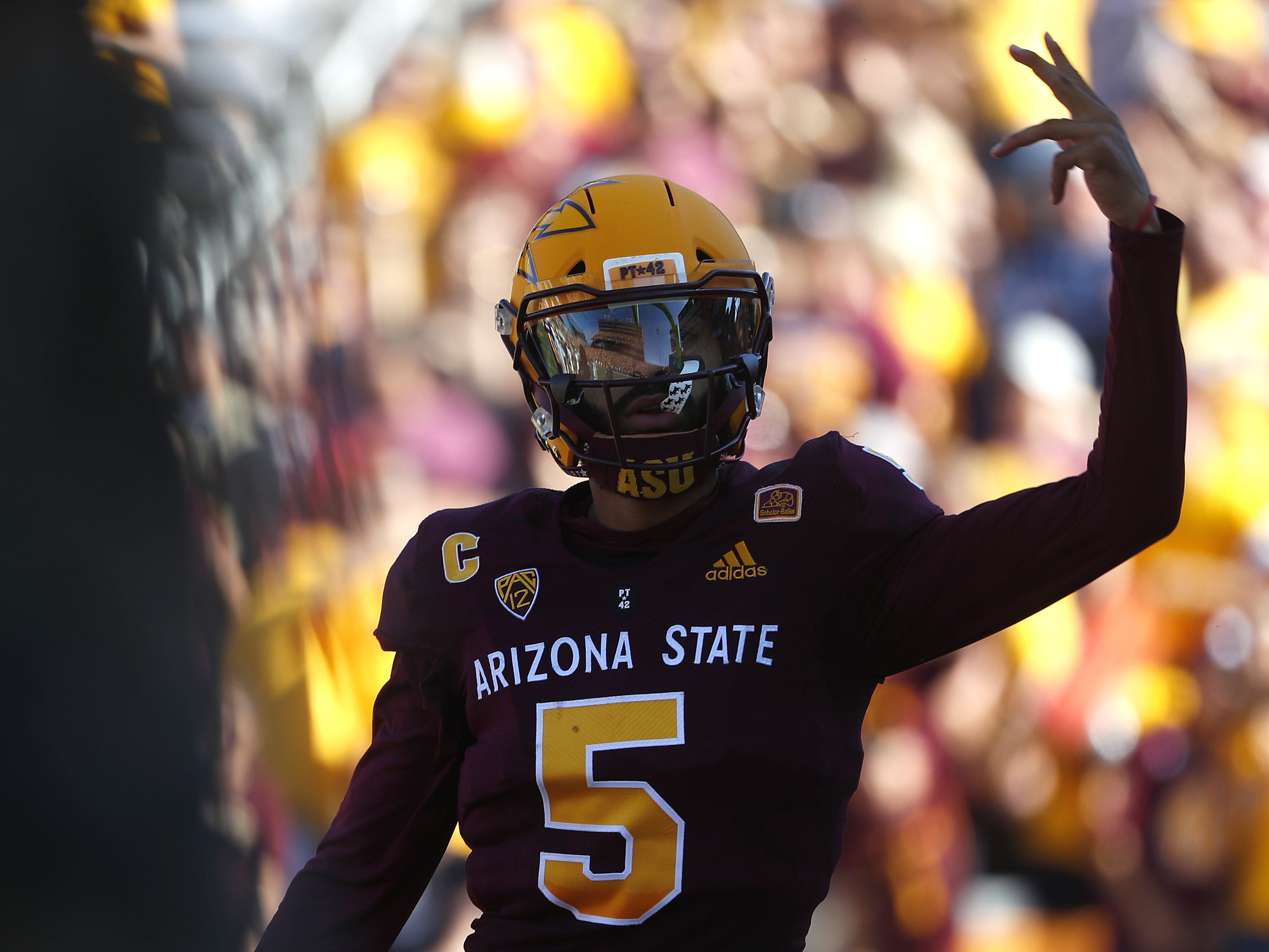 ASU's Manny Wilkins (5) celebrates a touchdown against UCLA during the first half at Sun Devil Stadium in Tempe, Ariz. on November 10, 2018.