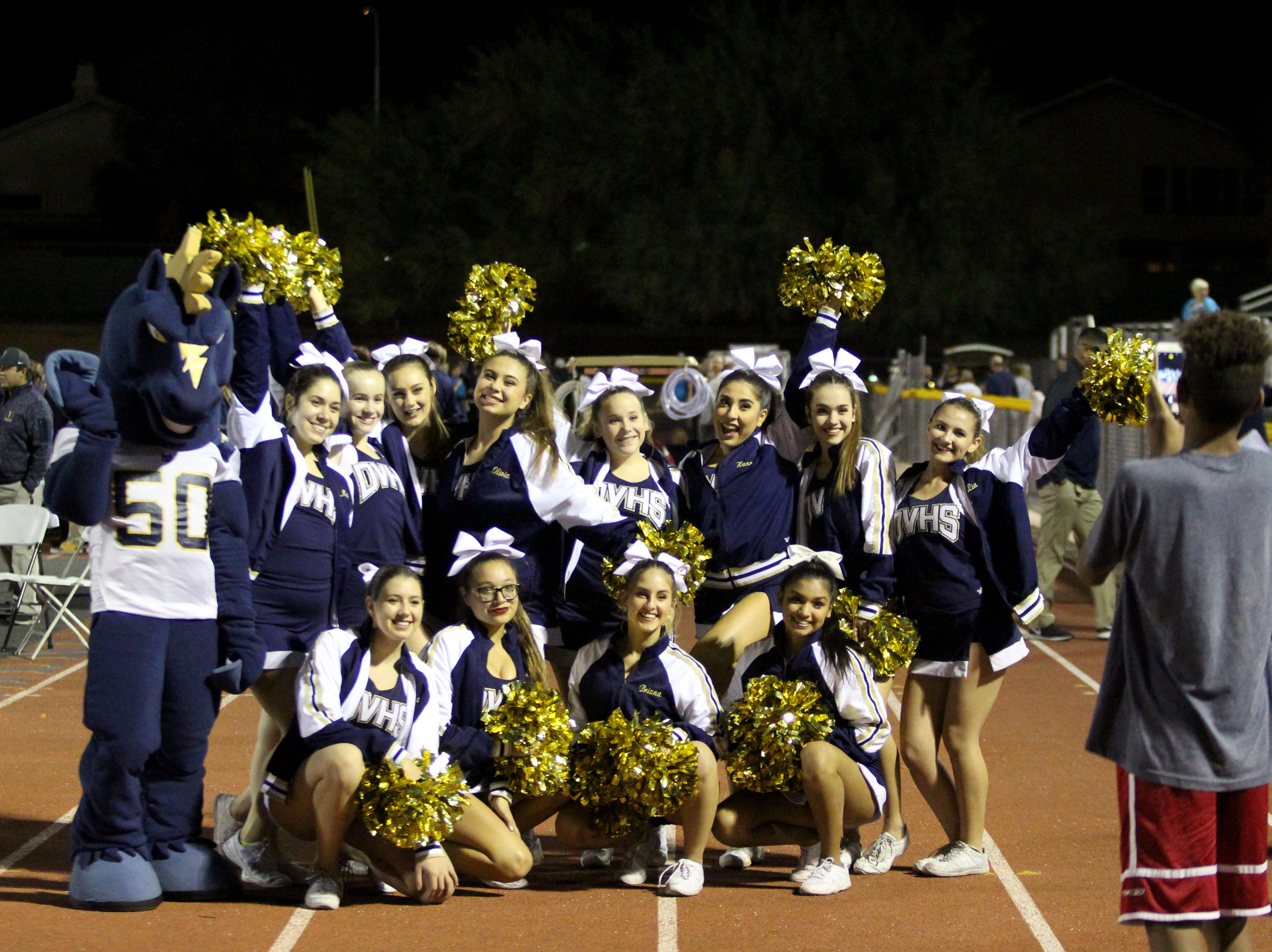 Desert Vista cheerleaders take a photo Friday night at Desert Vista High School on Nov. 9, 2018.