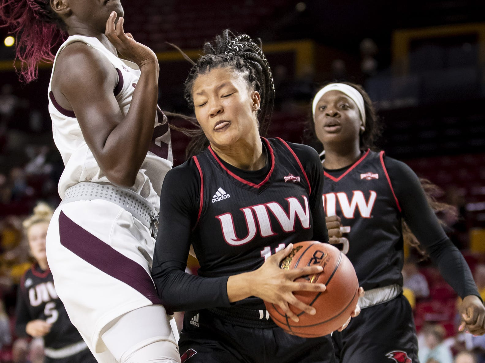 Guard Angelica Wiggins (12) of the Incarnate Word Cardinals rebounds against the Arizona State Sun Devils at Wells Fargo Arena on Tuesday, November 6, 2018 in Tempe, Arizona.