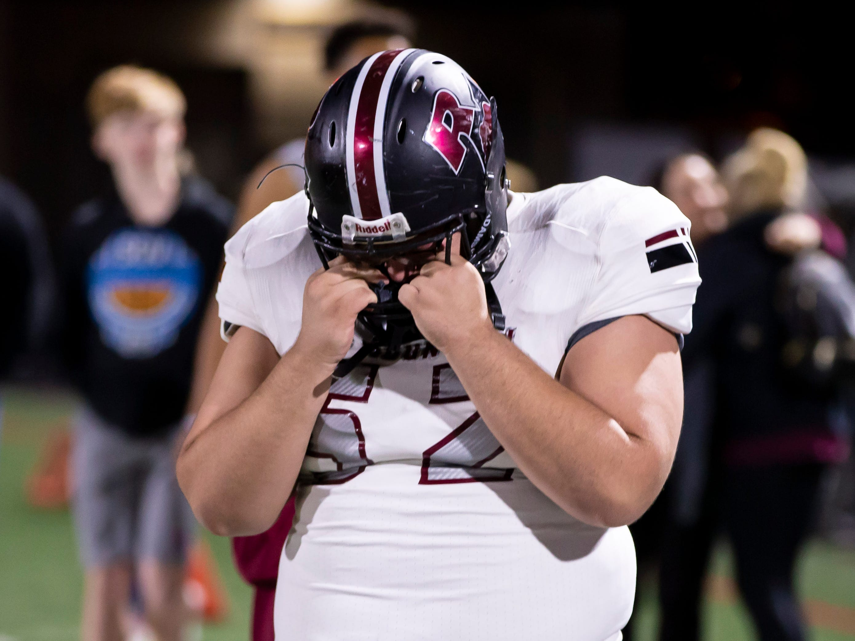 Senior center Gabriel Roberson (52) of the Red Mountain Mountain Lions reacts following Red Mountain's 41-20 loss against the Pinnacle Pioneers in the playoffs at Pinnacle High School on Friday, November 9, 2018 in Phoenix, Arizona. #azhsfb