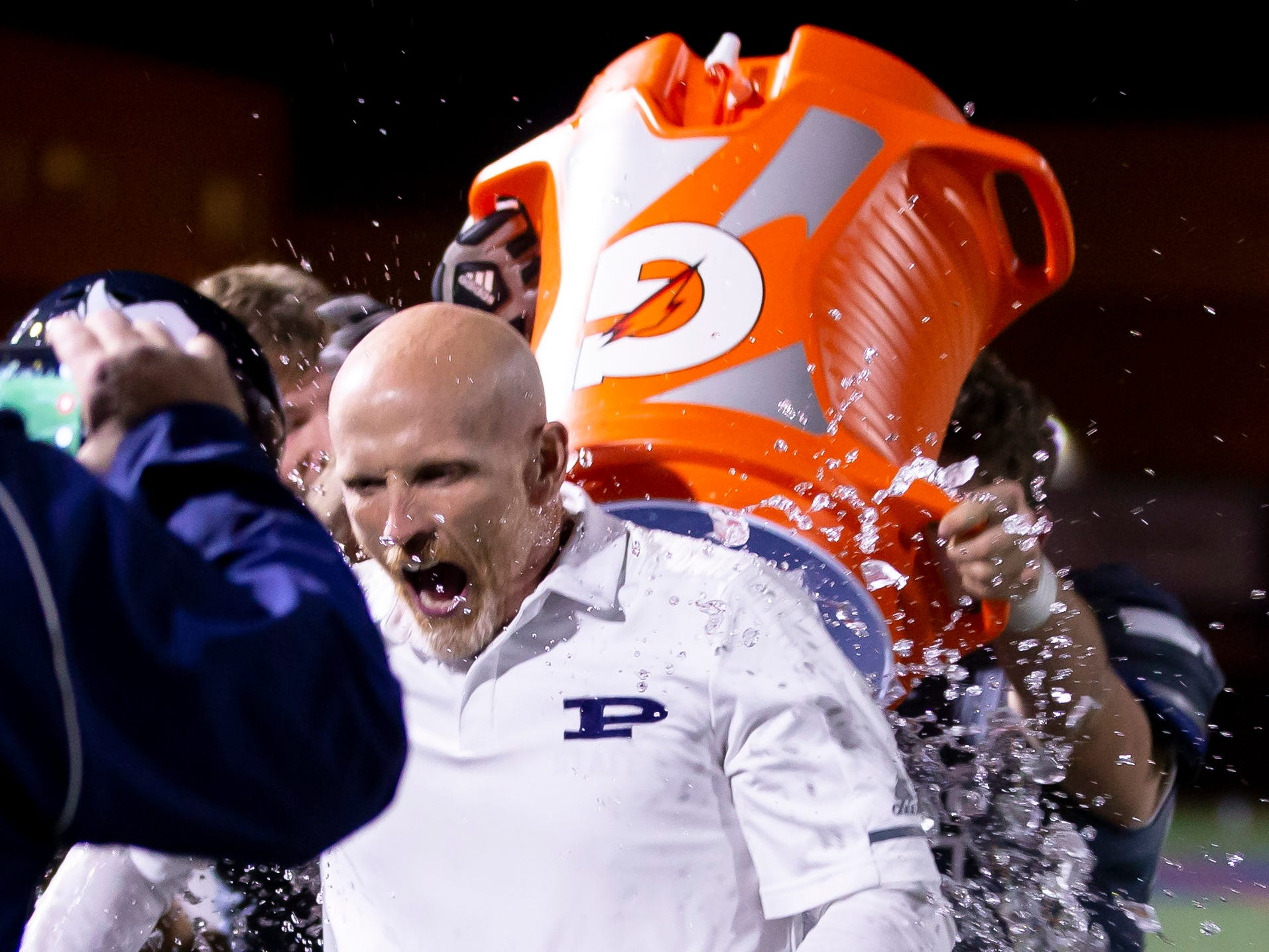 Head coach Dana Zupke of the Pinnacle Pioneers is ducked with ice water during the playoff game against the Red Mountain Mountain Lions at Pinnacle High School on Friday, November 9, 2018 in Phoenix, Arizona. #azhsfb
