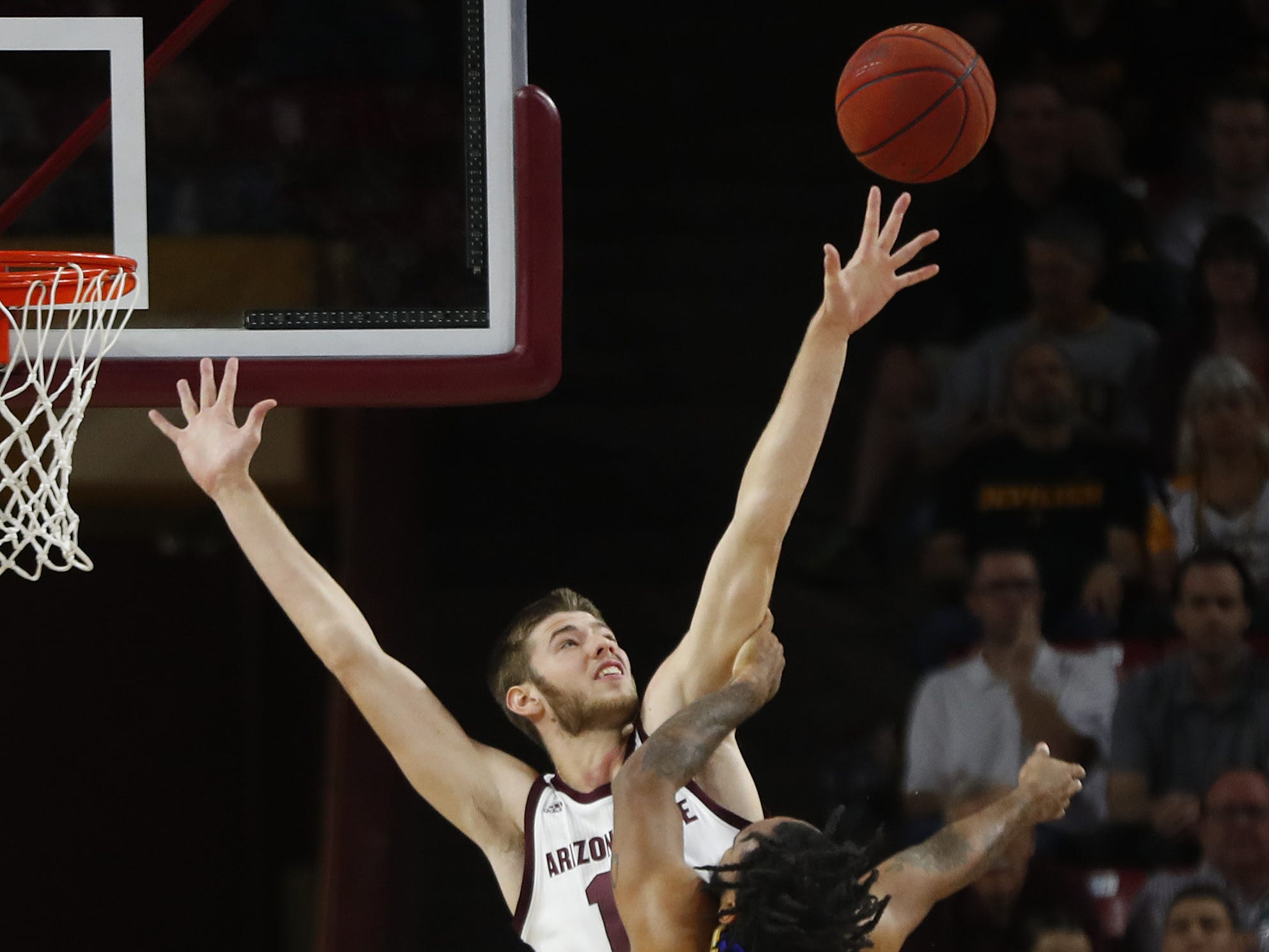 Arizona State's Vitaliy Shibel (10) challenges a shot from McNeese State's Will Robinson (24) during the first half at Wells Fargo Arena in Tempe, Ariz. on November 9, 2018.