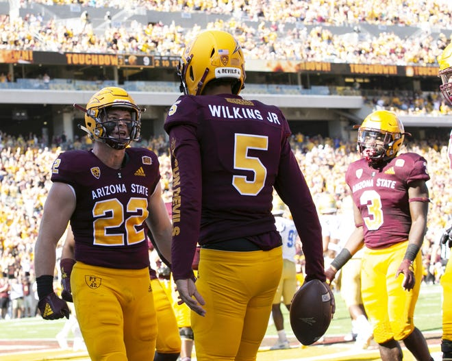 ASU quarterback Manny Wilkins reacts with ASU running back Nick Ralston after Wilkins scored a touchdown during the second quarter of the PAC-12 college football game against UCLA at Sun Devil Stadium in Tempe on Saturday, November 10, 2018.