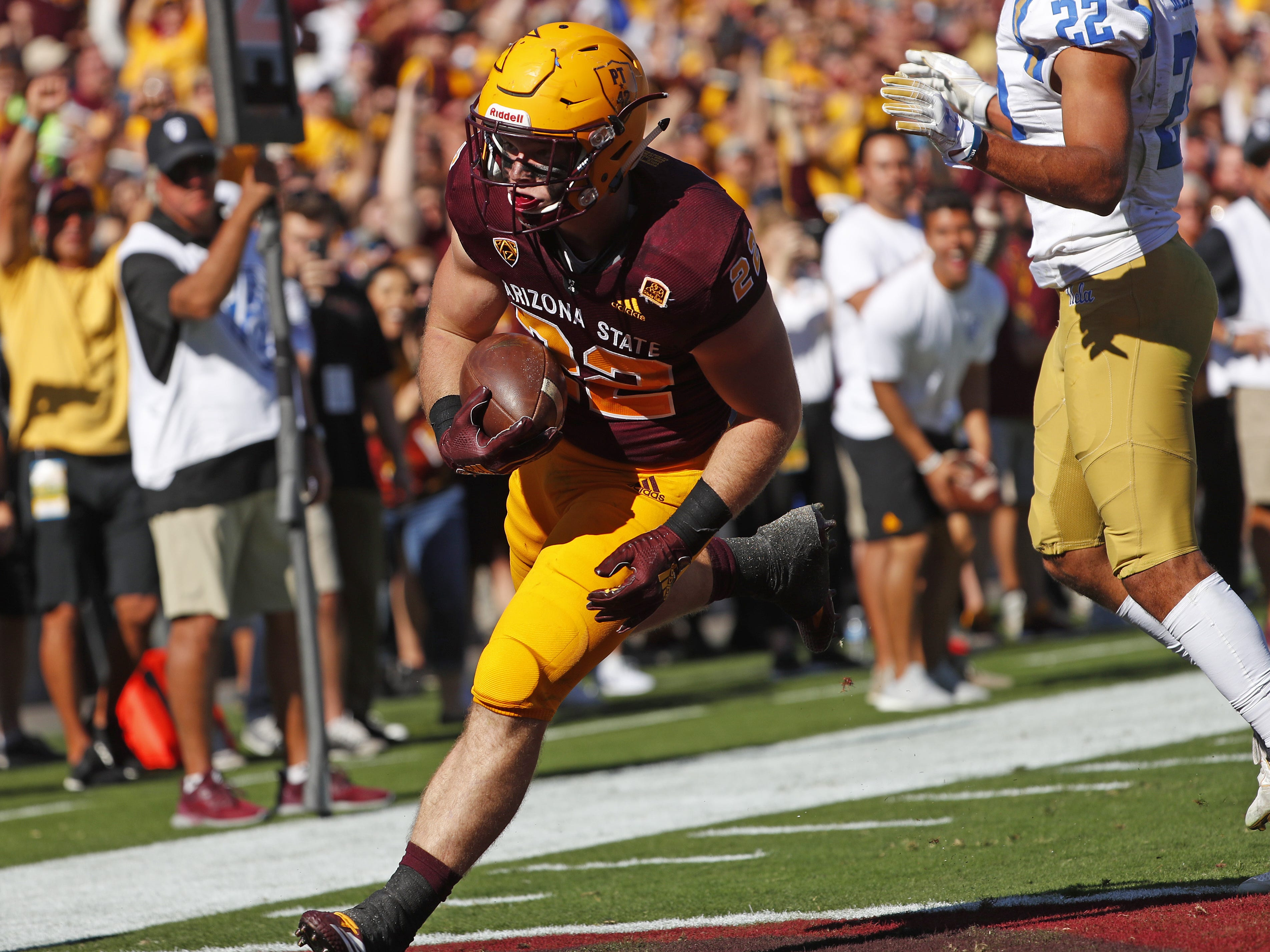 ASU's Nick Ralston (22) scores a touchdown against UCLA during the first half at Sun Devil Stadium in Tempe, Ariz. on November 10, 2018.