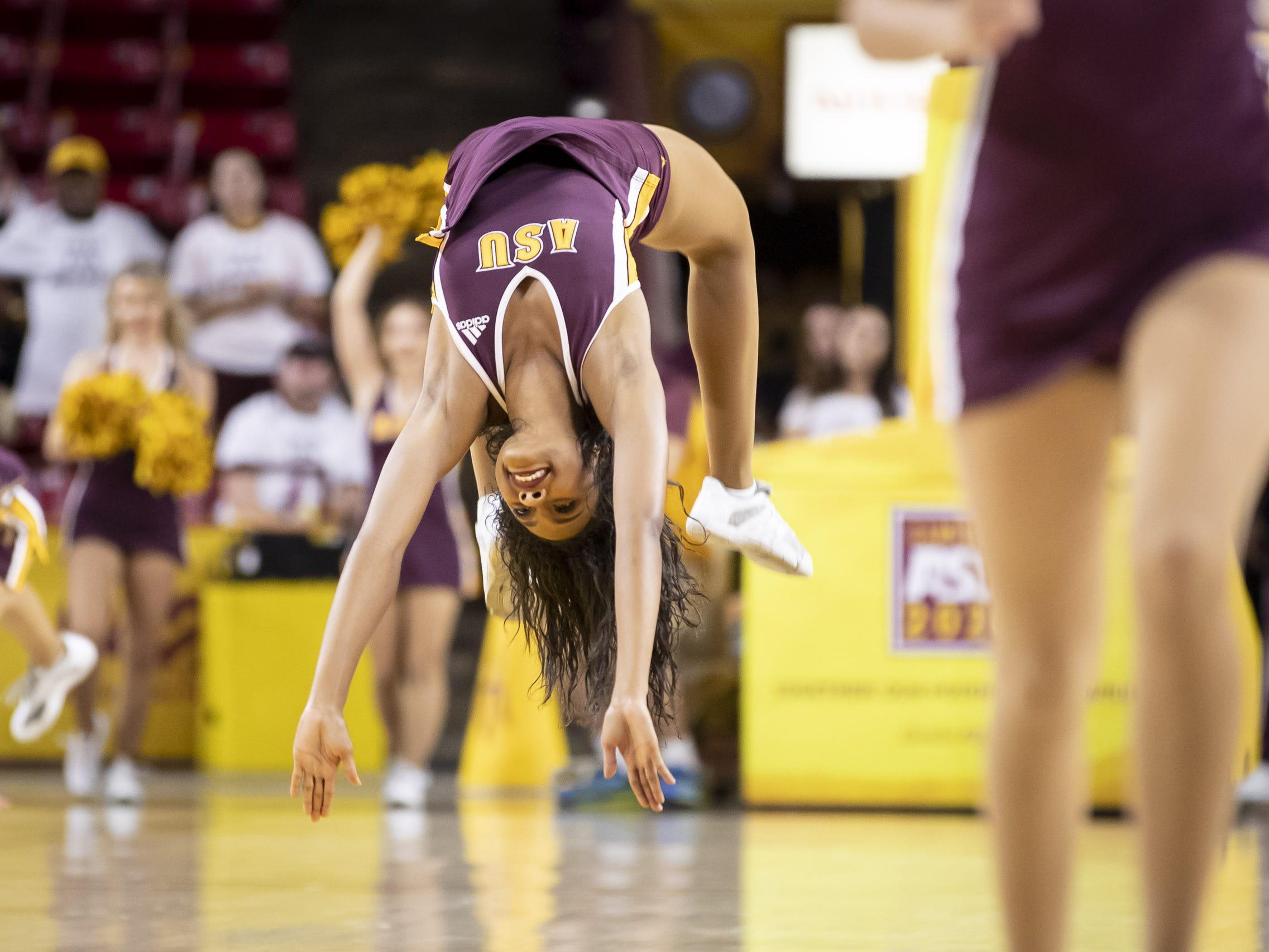 An Arizona State Sun Devil cheerleader tumbles during the game against the Incarnate Word Cardinals at Wells Fargo Arena on Tuesday, November 6, 2018 in Tempe, Arizona.