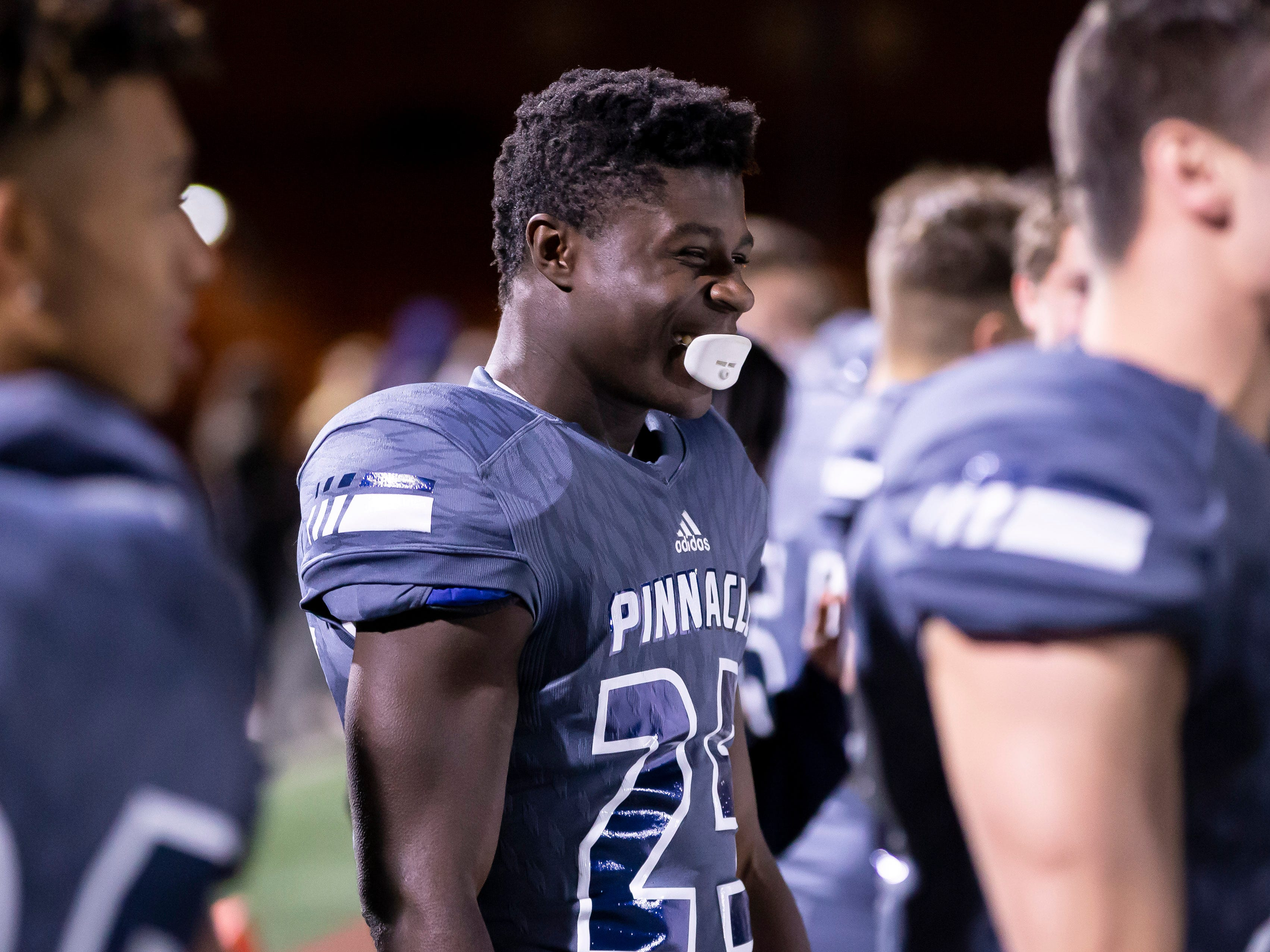 Senior linebacker Amelec Juntunen (25) of the Pinnacle Pioneers smiles during the playoff game against the Red Mountain Mountain Lions at Pinnacle High School on Friday, November 9, 2018 in Phoenix, Arizona. #azhsfb