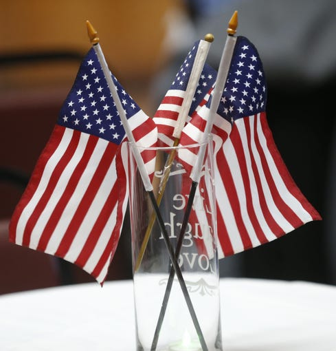 American flags sit in a vase during 7th annual Forgotten Heroes Appreciation Breakfast at Travis L. Williams American Legion Post 65 in Phoenix on Nov. 10, 2018.